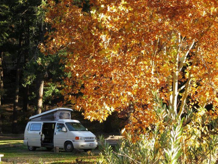 Camper van travel in autumn.