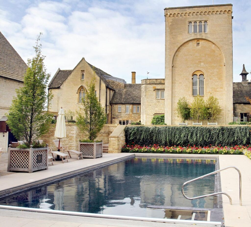 Outdoor pool with historic buildings.