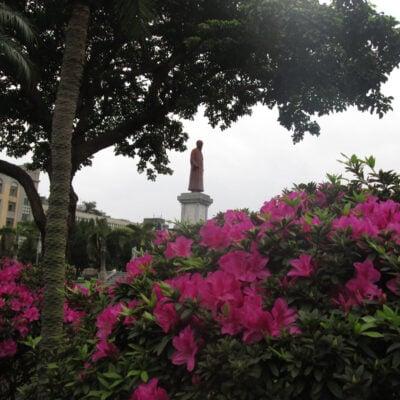 Taipei street scene with statue.