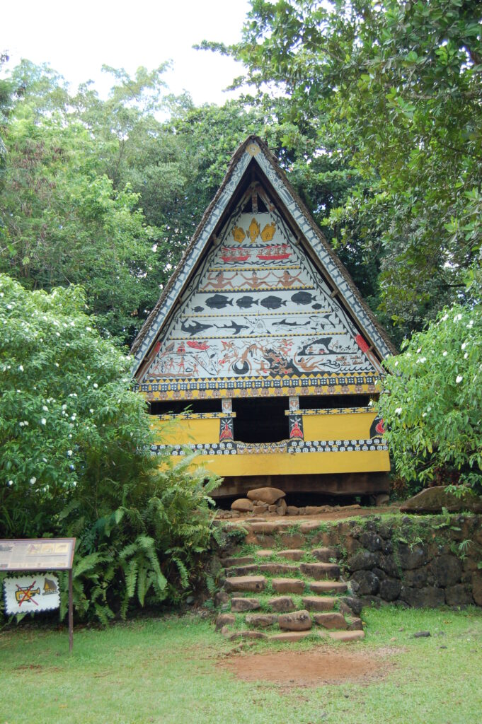 A Bai structure with traditional paint and carvings, outside the Belau National Museum, Palau.