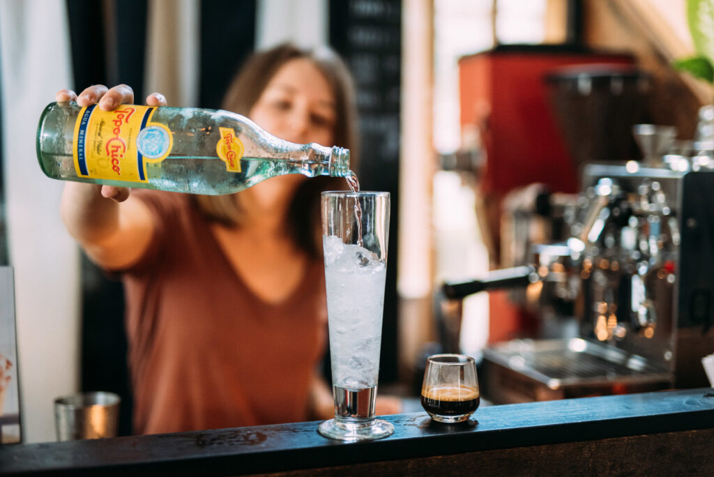 A bartender pours a drink at Gilly Brew Bar.