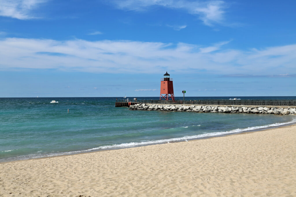 A beach and lighthouse in Charlevoix, Michigan.