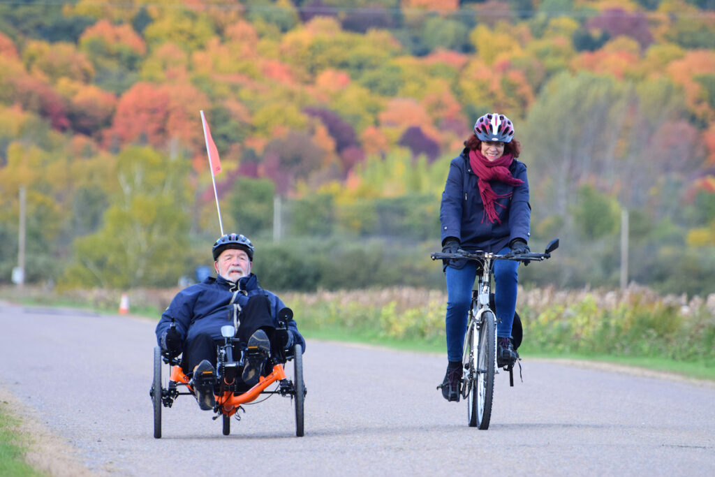 A biker and tricyclist on the trail.