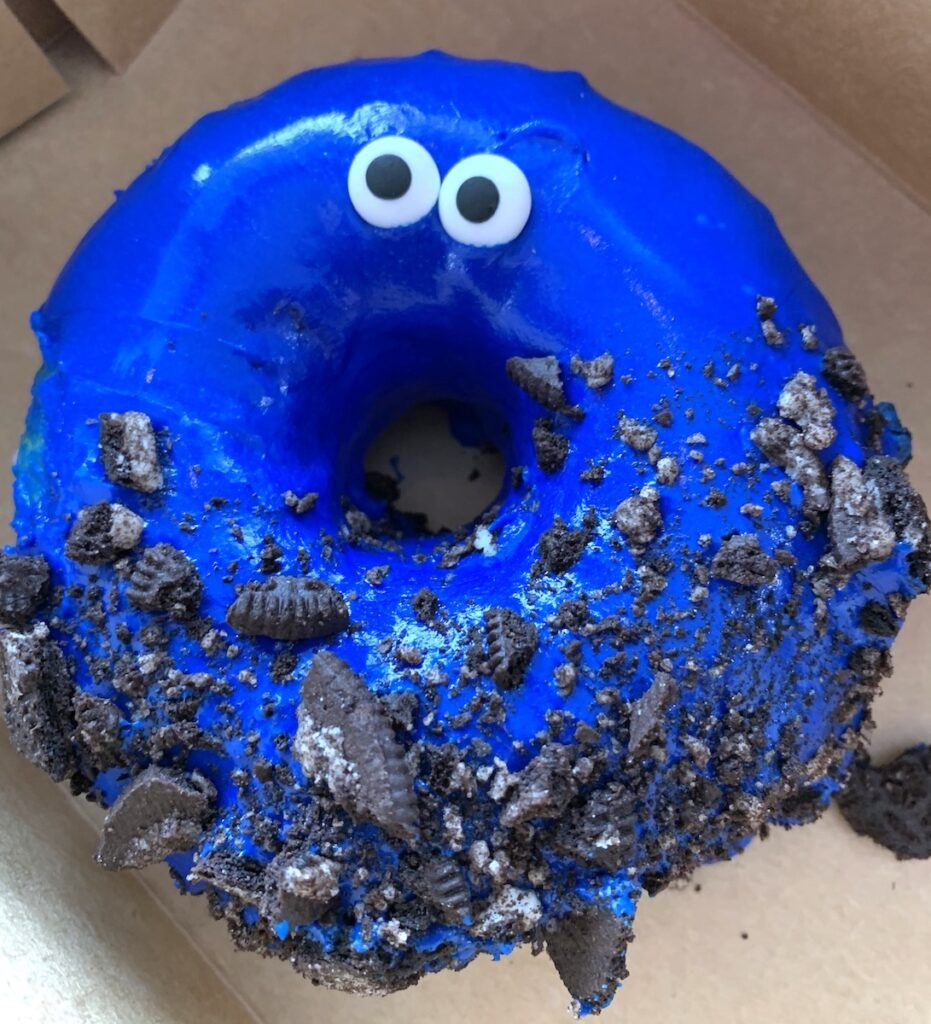 A blue donut from Hurts Donut.