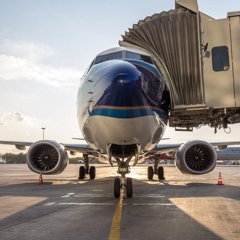 A Boeing 737 plane at an airport.