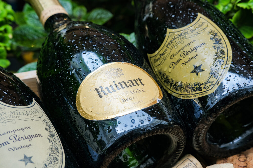 A bottle of Ruinart champagne.