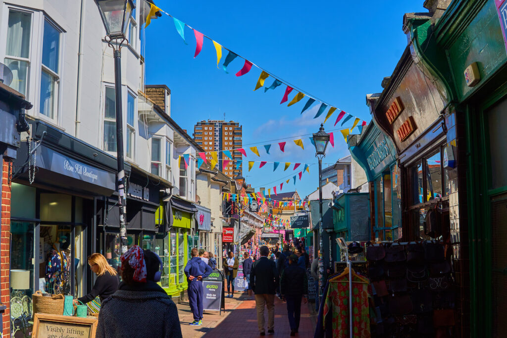 A busy street full of shops in Brighton's North Laine.