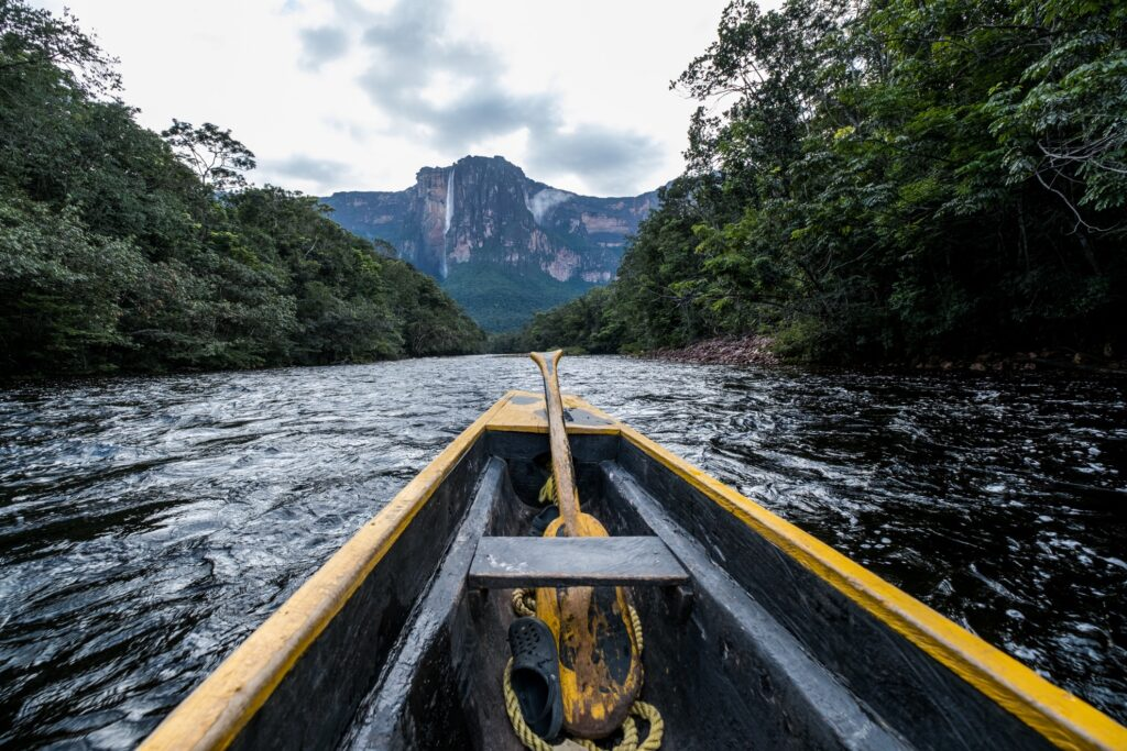 A canoe approaches Angel Falls.