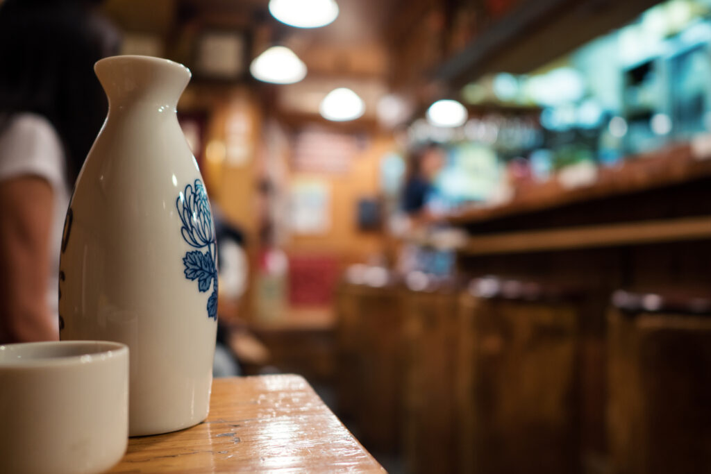 A ceramic sake bottle and cup