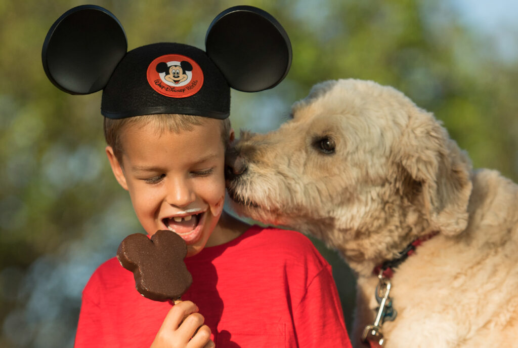 A child and a dog enjoying Disney's Fort Wilderness.