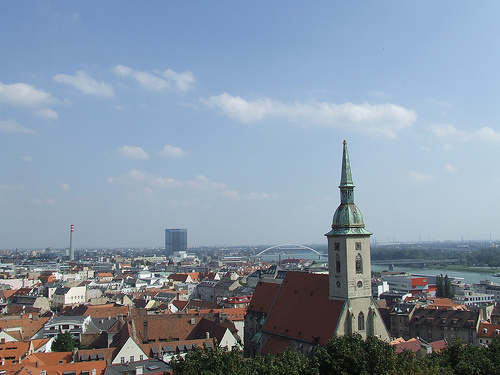 A church towers above the red roofs of Bratislava
