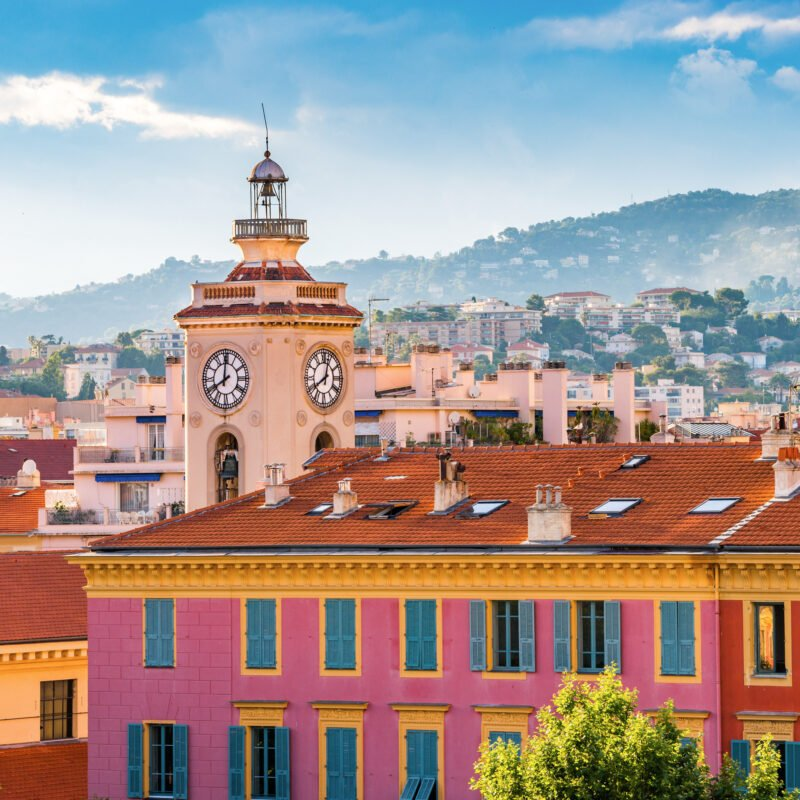 A clock tower over the Old Town of Nice, France.