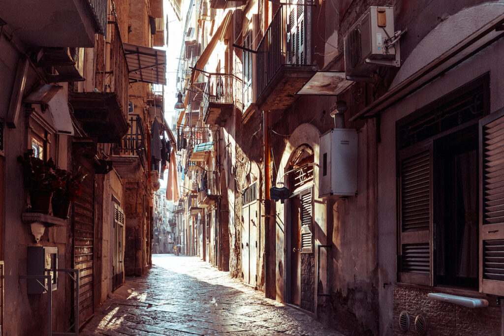 A cobblestone street in Old Naples, Italy.