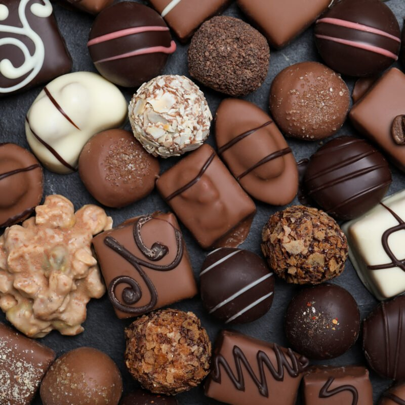 A collection of chocolate truffles.