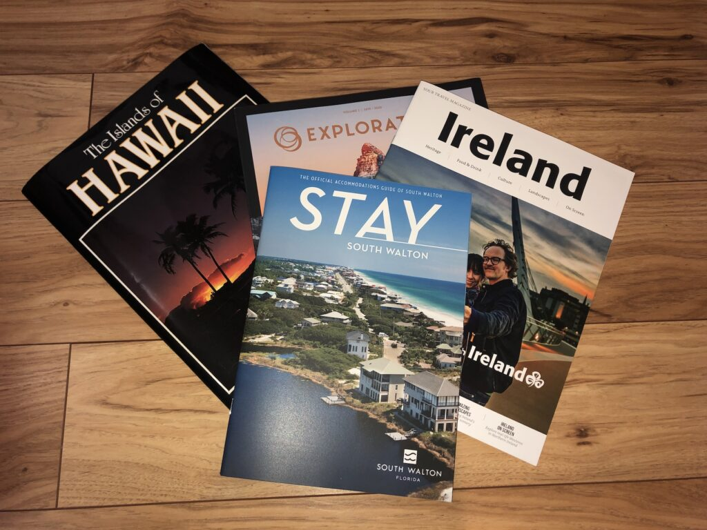A collection of travel brochures.