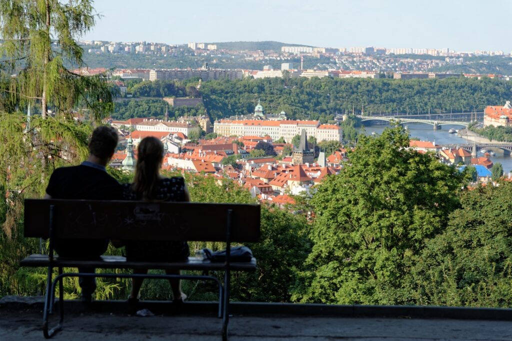 A couple admiring the view of Prague from Petrin Hill.