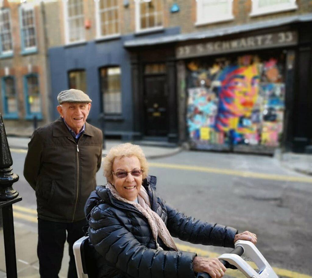 A couple enjoying an Alternative London street art tour