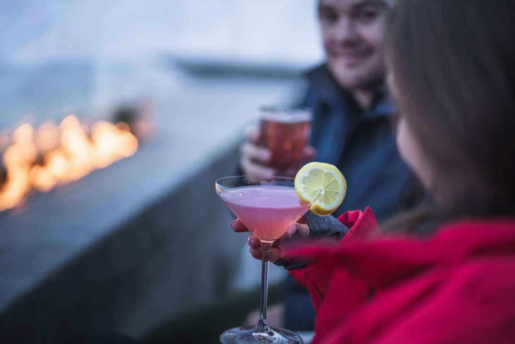 A couple enjoying drinks at the Josie Hotel in British Columbia.