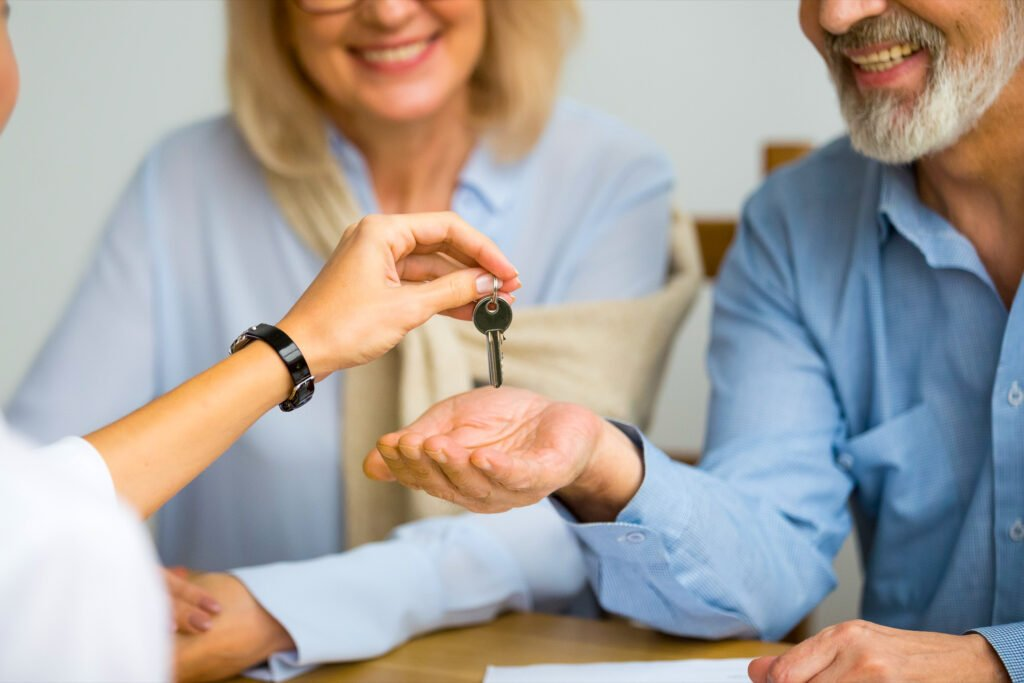 A couple receives the keys to their timeshare.