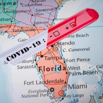A COVID test over a map of Florida.