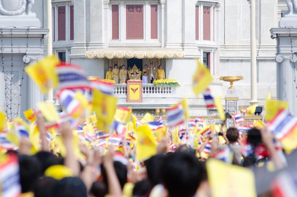 A crowd celebrating the birthday of King Bhumibol Adulyadej.