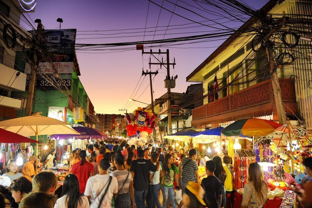 A crowded street of shops in Thailand.