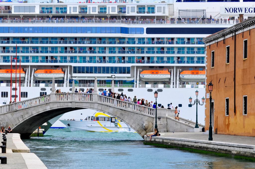 A cruise ship sails past Venice