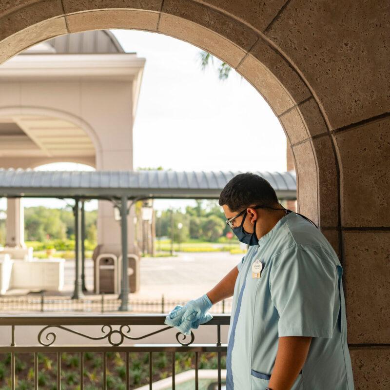 A Disney worker sanitizing the park.