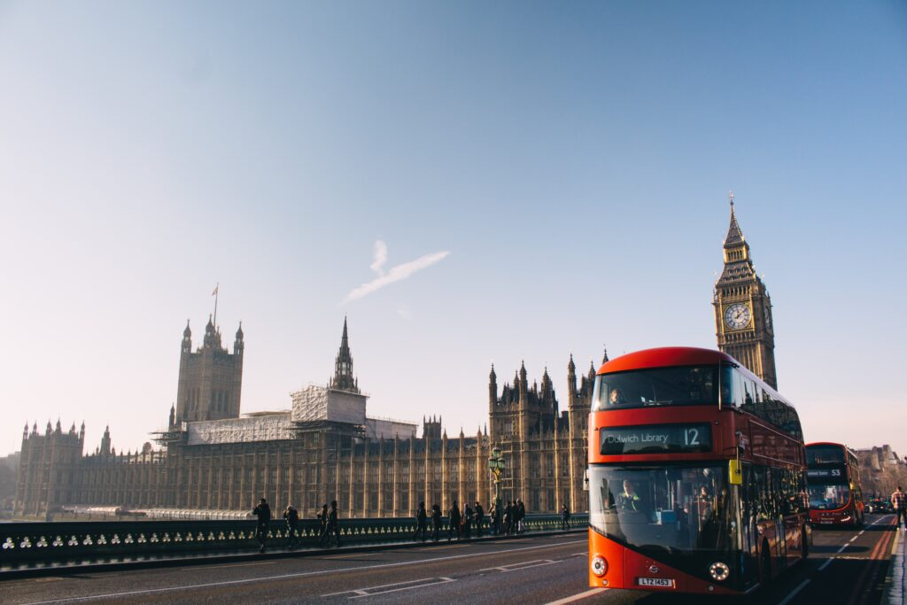 A double decker bus with Big Ben in the background