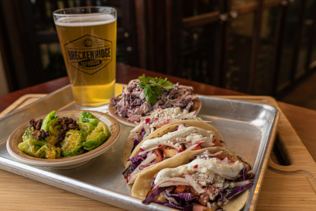 A drink, tacos, and an appetizer at Breckenridge Tap House.