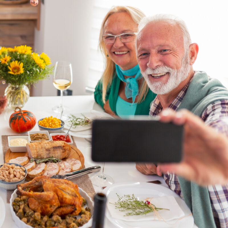 A family enjoying Thanksgiving dinner together via Zoom.