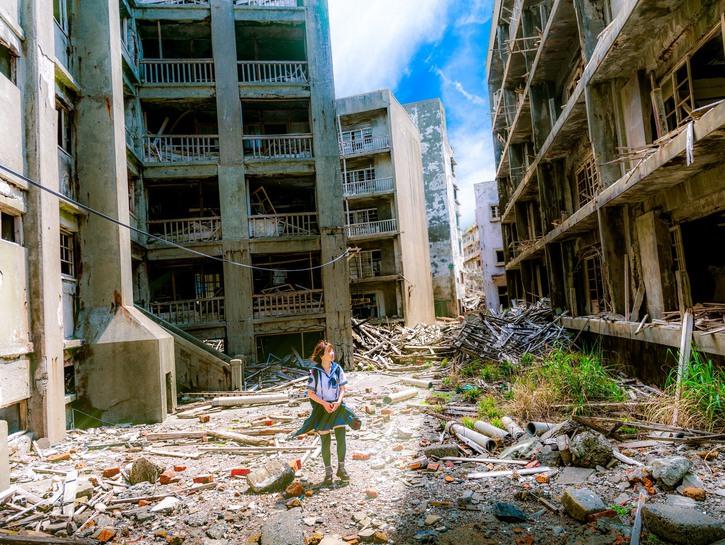 A female japanese student exploring the ruins of Hashima Island, Nagasaki