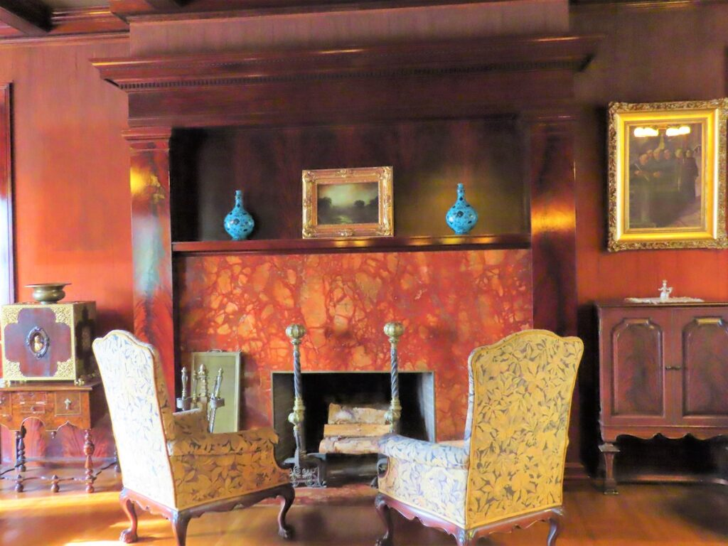 A fireplace and chairs at Glensheen.