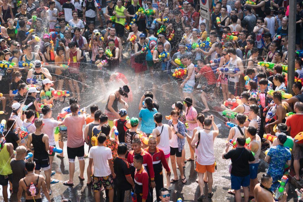 A giant water gun fight during Songkran in Thailand.