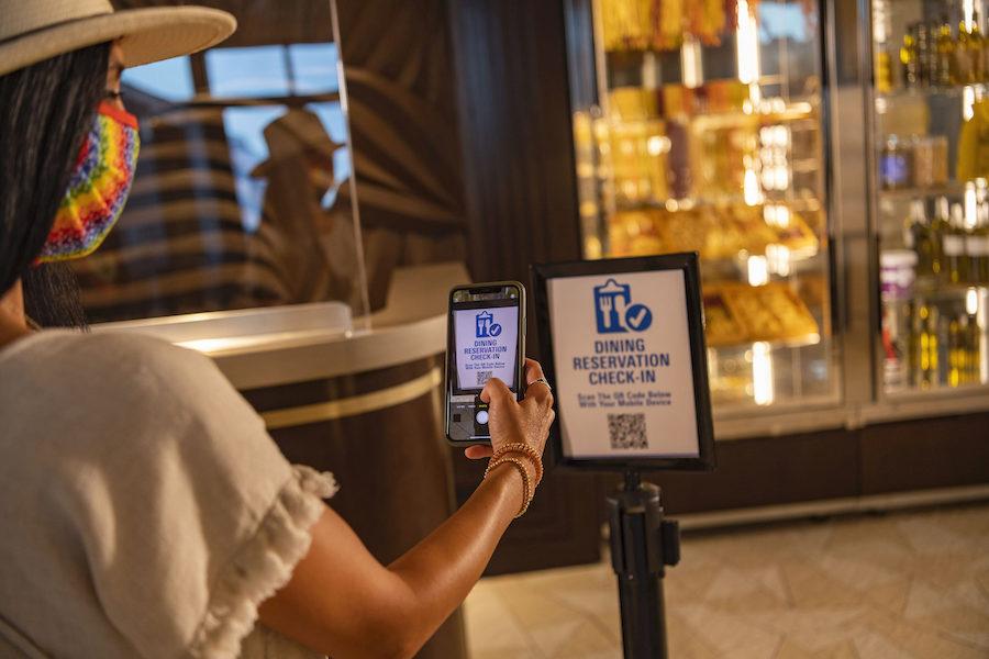A guest scanning a QR code at a restaurant.