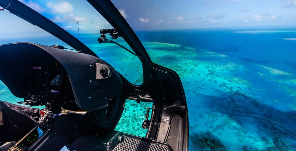 A helicopter flying over the Great Barrier Reef.