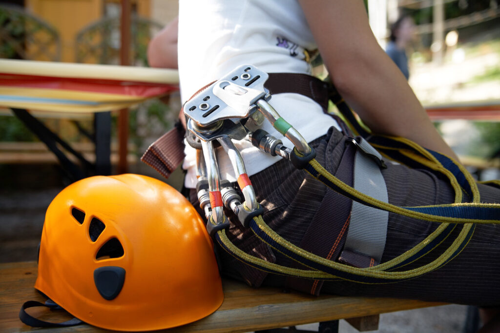 A helmet and safety gear for a zip line ride