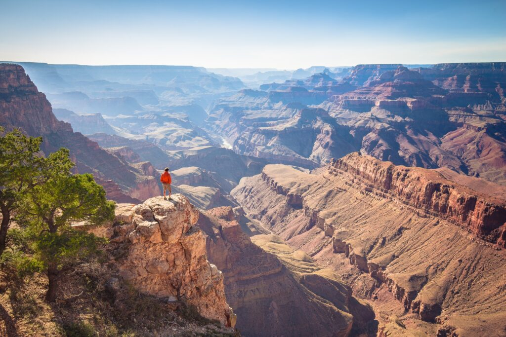 A hiker overlooking the Grand Canyon.