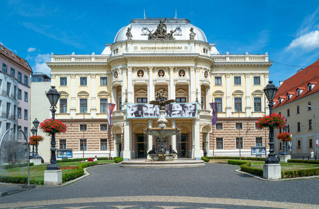 A historic white theater in Bratislava.