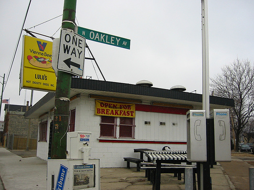 A hot dog stand with a prominently displayed vienna beef sign