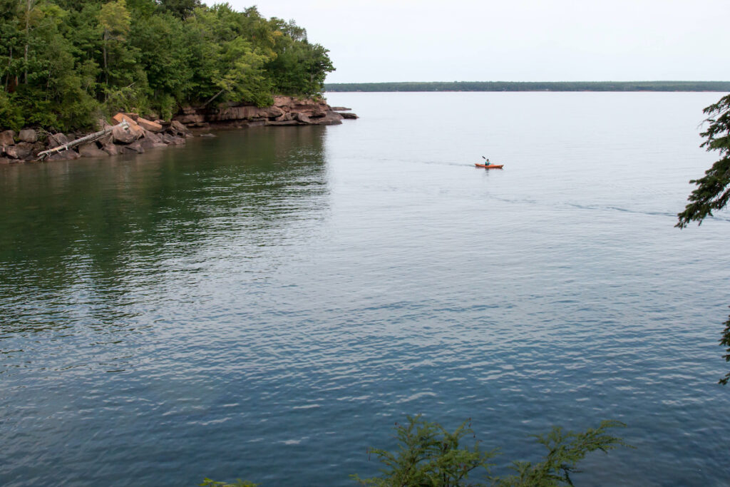 A kayaker off the coast of Madeline Island in Wisconsin.