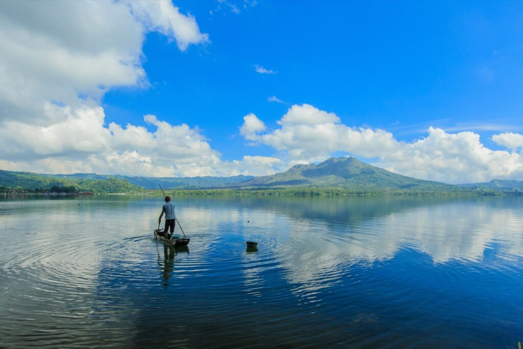 A lake in Bali with Mount Batur in the background.