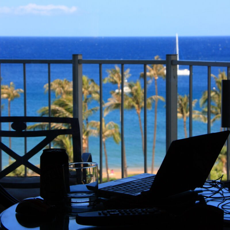 A laptop on a balcony in Hawaii.