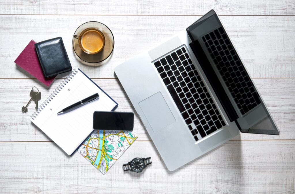 A laptop, phone, and travel supplies.