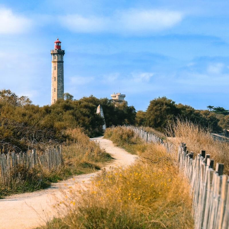A lighthouse on the beach on Ile De Re, France.