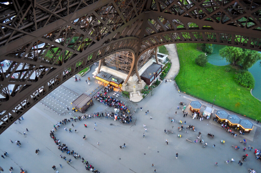A line of tourists at the Eiffel Tower.