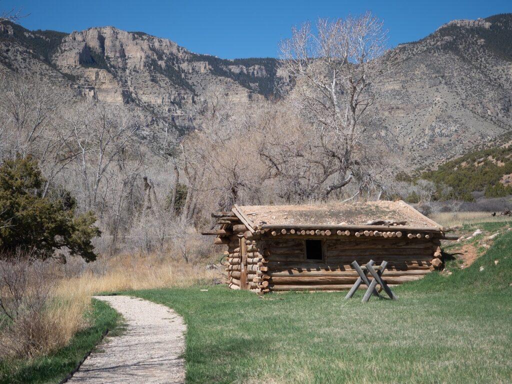 A log cabin near a trail.