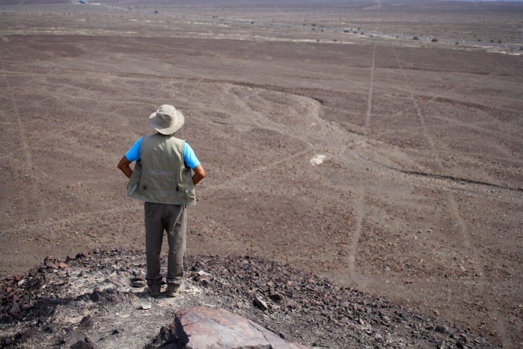A man admiring the Nazca Lines in Peru.