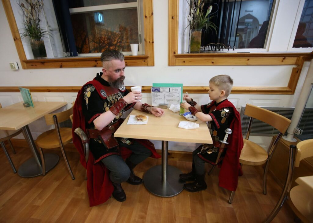 A man and his son dressed up for Up Helly Aa.