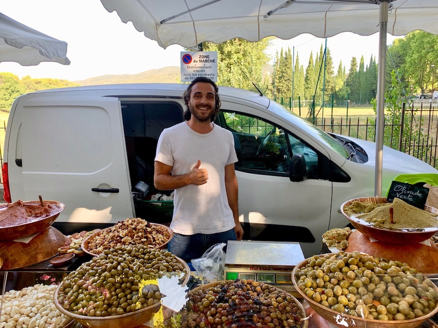 A man at an outdoor market in France.
